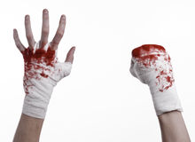 Shook his bloody hand in a bandage, bloody bandage, fight club, street fight, bloody theme, white background, isolated Royalty Free Stock Photography