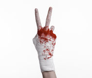 Shook his bloody hand in a bandage, bloody bandage, fight club, street fight, bloody theme, white background, isolated Royalty Free Stock Photo