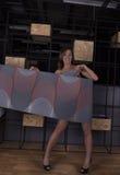 She shook a roll of wallpaper. Beautiful girl shook a roll of wallpaper Royalty Free Stock Photos