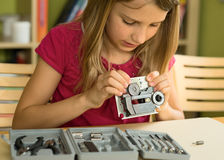 Shool girl busy. School girl busy with tools and mechanism Royalty Free Stock Photos
