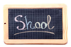 Shool. Handwritten with colorful chalks on a black chalkboard Royalty Free Stock Images
