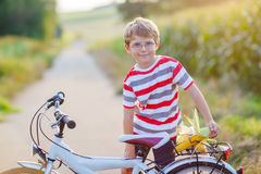 Shool kid boy having fun with riding of bicycle Royalty Free Stock Image
