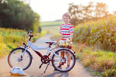Shool kid boy having fun with riding of bicycle Stock Photo