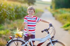 Shool kid boy having fun with riding of bicycle Royalty Free Stock Photo