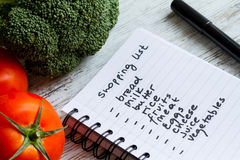 Shooping list. Preparing the shopping list before going to buy the groceries Stock Photography
