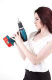 Shoot. Young brunette posing with drill Royalty Free Stock Images