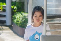 Shoot Asian little cute girl siting in goft car and thinking something. royalty free stock photo
