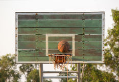 Shoot the ball of basketball into the basket Royalty Free Stock Images