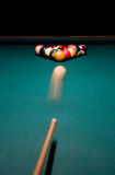 Shoot. Break racked pool balls. Shooting the white ball to break the racked billiard balls Royalty Free Stock Photography
