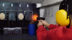 Shoot in dash from pistol. A man shoots a gun in the dash stock photo