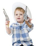 Shoot 'Em Up Cowboy. An adorable 2-year-old cowboy wielding a toy gun in each hand.  On a white background Stock Photography