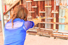 Shoot gun to doll royalty free stock images