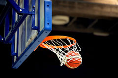 Shoot hoops and the ball on the basket Stock Photo