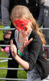 Shoot. Junior contestant concentrates at the world conker championships in Southwick, near Oundle, England on 12 october 2014 stock images