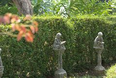 Kid`s statue reading book in Queen Sirikit Park stock photo