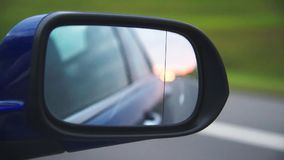 Rear-view on the road from mirror of car stock footage
