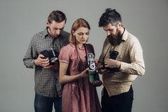 Shoot smart school. Retro style woman and men hold analog photo cameras. Paparazzi or photojournalists with vintage old. Shoot smart school. Retro style women stock photos