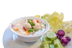 Shoot from studio. Thai style crab stew in coconut milk with fresh vegetable is one of a delicious Thai food, on white background.(With warm light filter effect Stock Photo