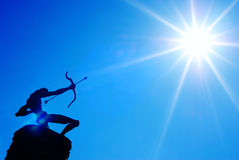 Shoot sun with bow and arrow. Statue of a hunter shoot sun with bow and arrow Stock Image