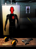 Shoot training room. Training room for shooting, with human-shape silhouette as target with five impacts, ear protector and automatic gun Royalty Free Stock Photo