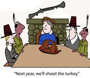 Shoot the turkey. The Indians and the Pilgrims have Thanksgiving with a blown up turkey Royalty Free Stock Image