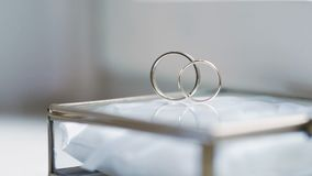 Gold wedding rings. Shoot of two wedding rings in a box on table stock footage
