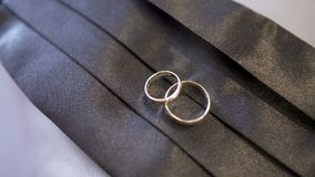 Wedding Rings in Decorated Box. Shoot of two wedding rings in a box on table stock video footage