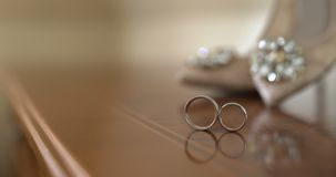 Wedding Rings in Decorated Box. Shoot of two wedding rings in a box on table stock footage