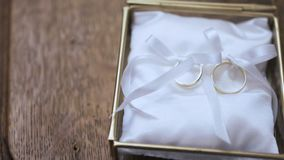Wedding rings in decorated box on the altar in church. Shoot of two wedding rings in a box on table stock video footage