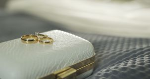Wedding Rings in Decorated Box 4K. Shoot of two wedding rings in a box on table stock video