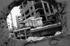 View of a construction site through a hole in the wall stock photo