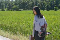 Shoot woman portrait in rice field. stock photos