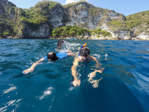 Shoot of a young boy snorkeling with father. Young boy snorkeling with father in a tropical sea in Nusa penida, Indonesia, Bali Stock Photo