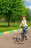 Shoot of young woman with bicycle Stock Images