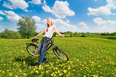 Shoot of young woman with bicycle Stock Photos
