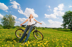 Shoot of young woman with bicycle. Outdoor shoot of young woman with bicycle Royalty Free Stock Photo