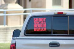 Shoot your local heroin dealer sign. At truck Royalty Free Stock Image