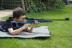 The Shooter. A young boy aims confidently with a target shooting air-rifle Stock Images