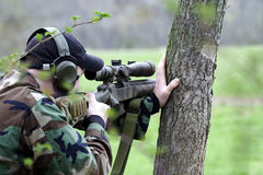 Shooter Against Tree Stock Photo