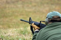 Shooter Aiming Down Range Stock Photography