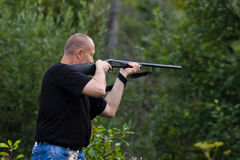 The shooter aiming from a gun at target Stock Photos