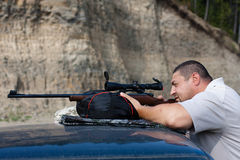 The shooter aiming from a rifle at target Royalty Free Stock Image