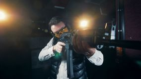 One man holding a big rifle at a shooting range, close up. stock footage