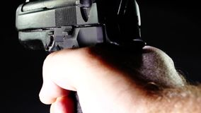 Shooter firing pistol from first person POV. Shooter firing 9 mm pistol from first person POV stock footage