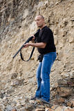 The shooter with a gun in hands Stock Image
