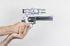 Shooter holds .357 Magnum Revolver. With dot sight stock photography