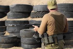 Shooter with a Kalashnikov assault rifle Stock Images