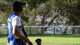 Shooter man aiming and firing a rifle sport in championship skeet a sunny day stock video footage