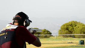Shooter man firing a rifle sport in championship skeet a sunny day stock video footage