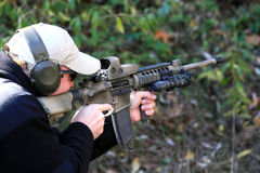 Free Shooter Pointing AR15 Stock Image - 2448351